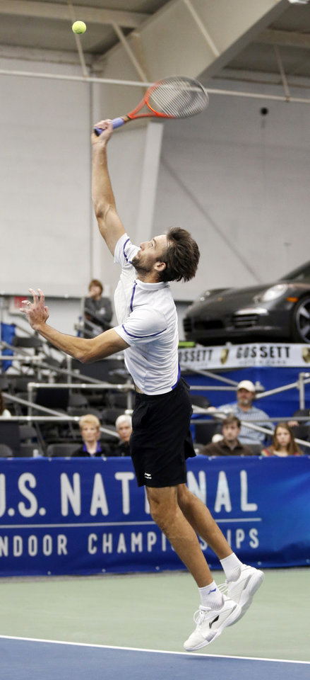 Photo - Ivo Karlovic, of Croatia, serves to Kei Nishikori, of Japan, in the singles final at the U.S. National Indoor Tennis Championships on Sunday, Feb. 16, 2014, in Memphis, Tenn. (AP Photo/Rogelio V. Solis)
