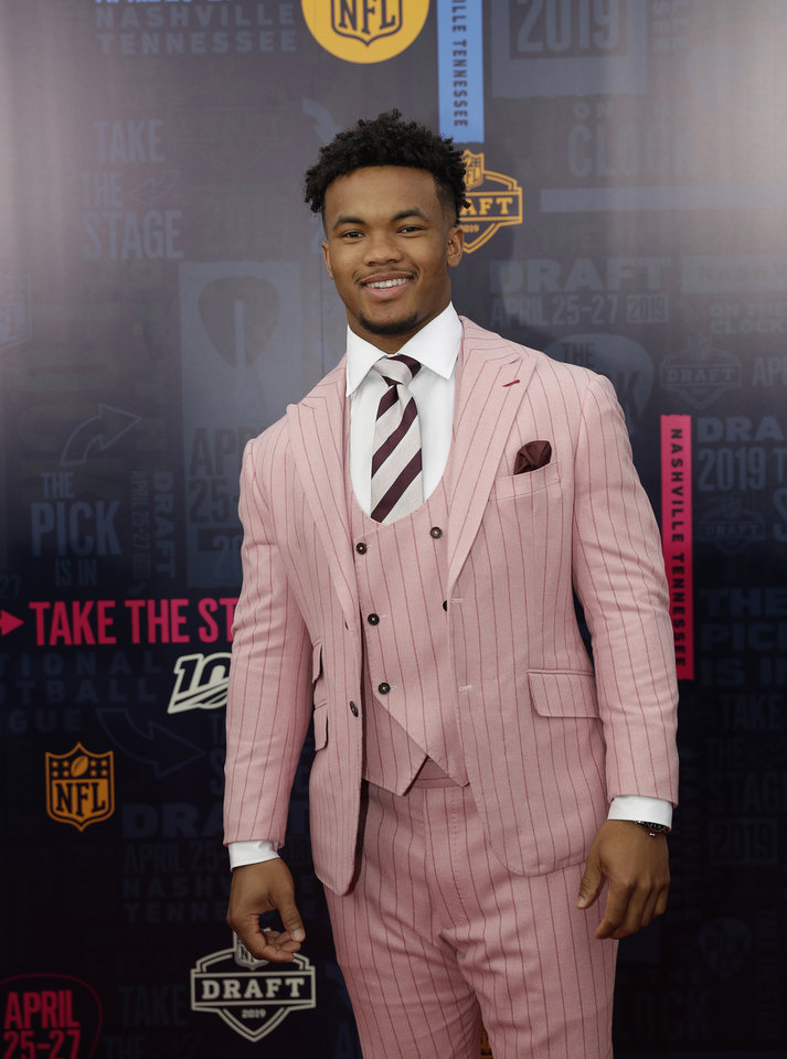 Photo - Oklahoma quarterback Kyler Murray walks the red carpet ahead of the first round at the NFL football draft, Thursday, April 25, 2019, in Nashville, Tenn. (AP Photo/Mark Humphrey)