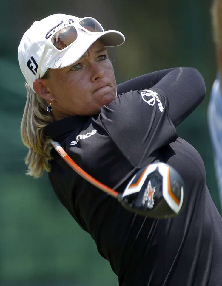 Photo - Katherine Kirk, of Australia, watches her tee shot on the eighth hole during the first round of the U.S. Women's Open golf tournament in Pinehurst, N.C., Thursday, June 19, 2014. (AP Photo/John Bazemore)