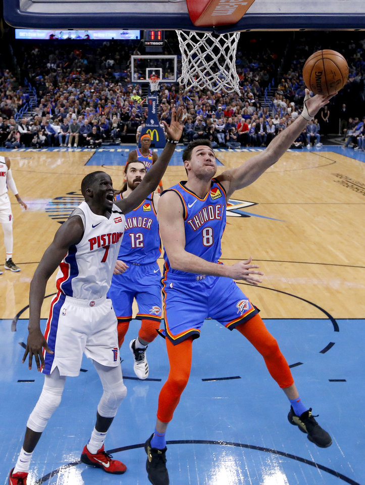 Photo - Oklahoma City's Danilo Gallinari (8) goes up for a lay up as Detroit's Thon Maker (7) defends during NBA basketball game between the Oklahoma City Thunder and the Detroit Pistons at the Chesapeake Energy Arena in Oklahoma City, Friday, Feb. 7, 2020.  [Sarah Phipps/The Oklahoman]