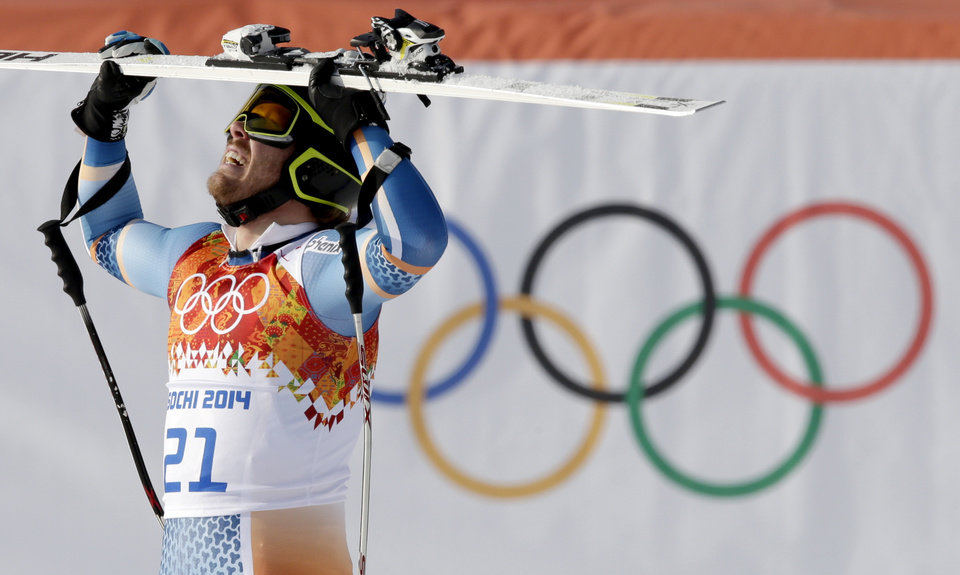 Photo - Norway's Kjetil Jansrud celebrates after taking the lead in the men's super-G at the Sochi 2014 Winter Olympics, Sunday, Feb. 16, 2014, in Krasnaya Polyana, Russia. (AP Photo/Gero Breloer)