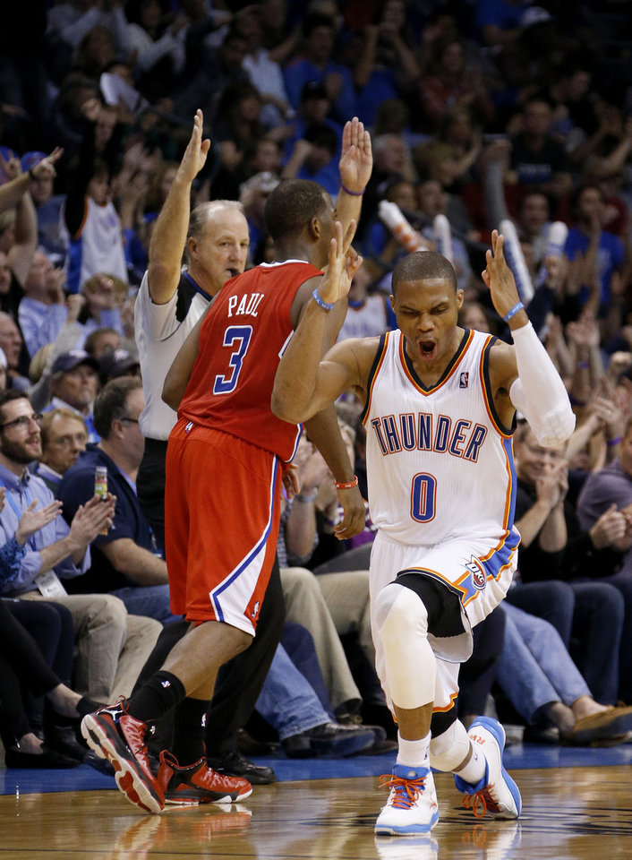 Oklahoma City's Russell Westbrook (0) reacts in front of the Clippers Chris Paul (3) during an NBA basketball game between the Oklahoma City Thunder and the Los Angeles Clippers at Chesapeake Energy Arena in Oklahoma City, Wednesday, Nov. 21, 2012. Photo by Bryan Terry, The Oklahoman