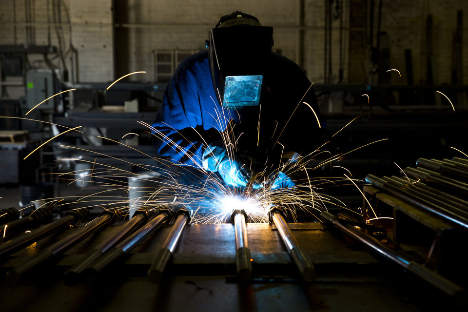 Photo - In this July 16, 2014 photo, a welder fabricates anchor bolts for roads and bridges at the custom manufacturer Fox Company Inc. in Philadelphia. The Institute for Supply Management, a trade group of purchasing managers, issues its index of manufacturing activity for July on Friday, Aug. 1, 2014. (AP Photo/Matt Rourke)