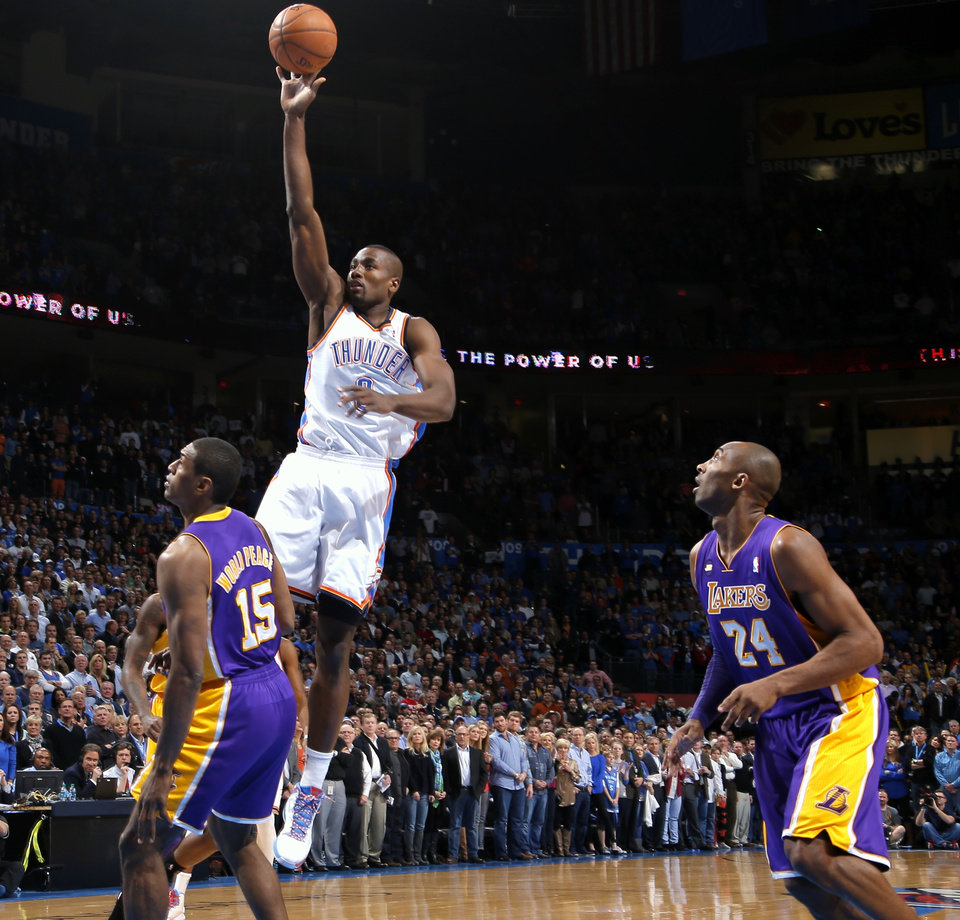 Oklahoma City\'s Serge Ibaka goes to the basket beside Los Angeles\' Metta World Peace and Kobe Bryant, right, during an NBA basketball game between the Oklahoma City Thunder and the Los Angeles Lakers at Chesapeake Energy Arena in Oklahoma City, Tuesday, March 5, 2013. Photo by Bryan Terry, The Oklahoman