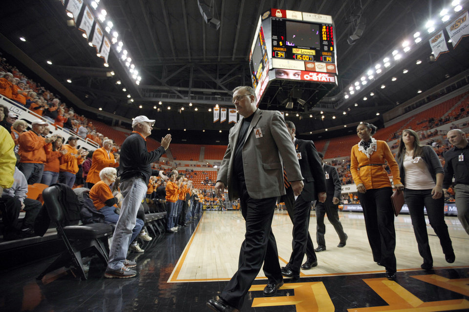 Photo - Oklahoma State Interim head coach Jim Littell walks off the court during half time  the women's college game between Oklahoma State University and Coppin State at Gallagher-Iba Arena in Stillwater, Okla.,  Saturday, Nov. 26, 2011.  Photo by Sarah Phipps, The Oklahoman