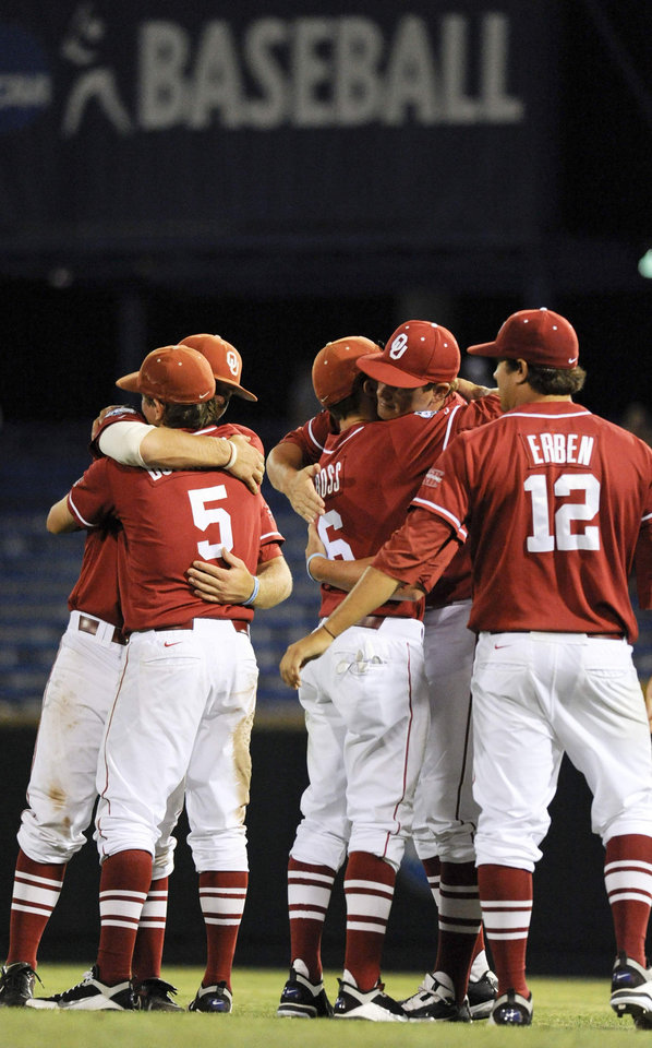 Photo - OU / COLLEGE BASEBALL: University of Oklahoma players console each other after South Carolina beat Oklahoma 3-2 in 12 innings in an NCAA College World Series baseball elimination game, in Omaha, Neb., Thursday, June 24, 2010. (AP Photo/Eric Francis) ORG XMIT: NENH117