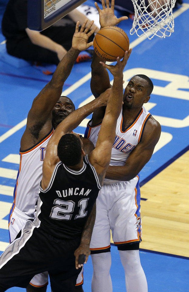 Photo - Oklahoma City's Serge Ibaka (9) and Oklahoma City's Kendrick Perkins (5) defend against San Antonio's Tim Duncan (21) during Game 4 of the Western Conference Finals in the NBA playoffs between the Oklahoma City Thunder and the San Antonio Spurs at Chesapeake Energy Arena in Oklahoma City, Tuesday, May 27, 2014. Photo by Bryan Terry, The Oklahoman
