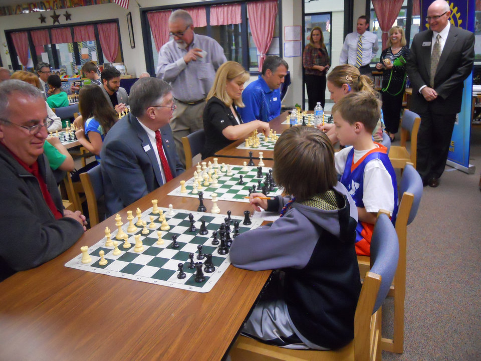 Ida Freeman Elementary Chess Club teaches Edmond Rotarians how to play before they head to national competition May 10