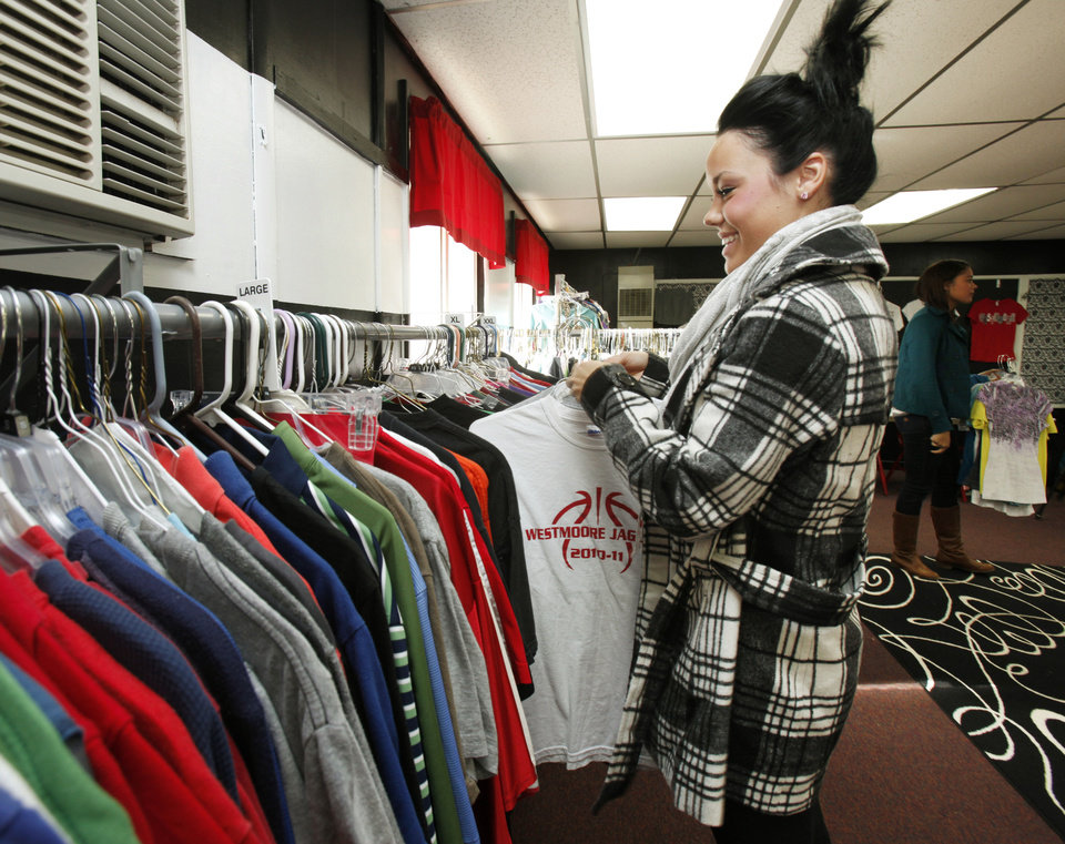 Student Hannah Scott hangs up clothing donations at Westmoore High School in Moore, OK, Tuesday, Nov. 22, 2011. Westmoore High School is being creative in giving back with a program for giving clothes to students who can't afford them. By Paul Hellstern, The Oklahoman