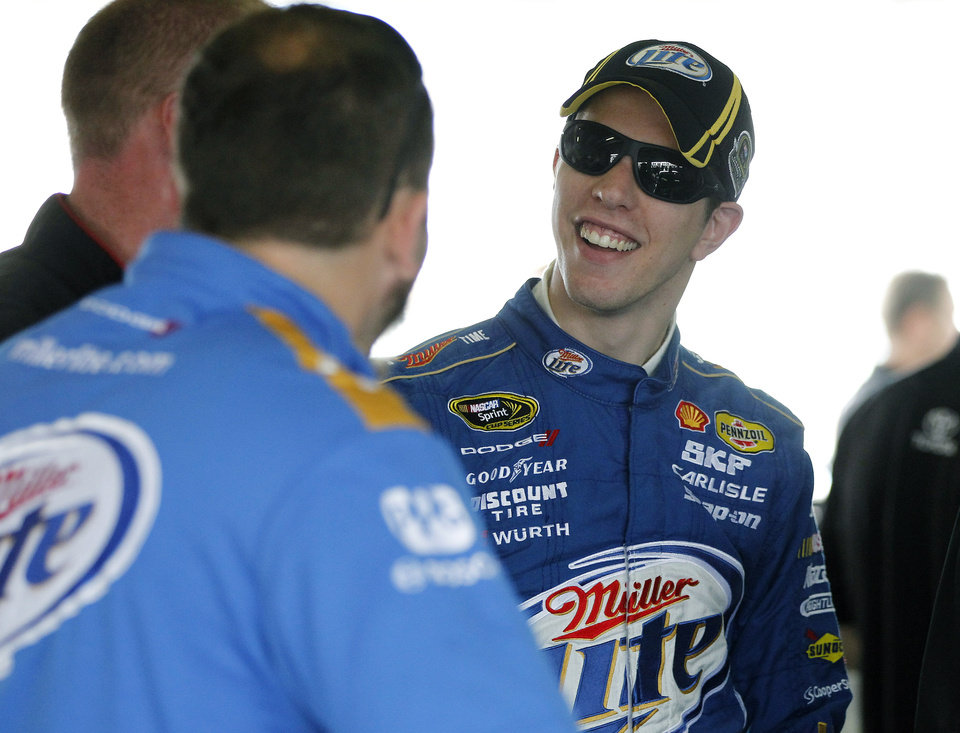 Photo -   Driver Brad Keselowski talks to his crew during the practice session for Sunday's NASCAR Sprint Cup Series auto race, Sunday, at the Homestead-Miami Speedway in Homestead, Fla., Friday, Nov. 16, 2012. (AP Photo/Terry Renna)