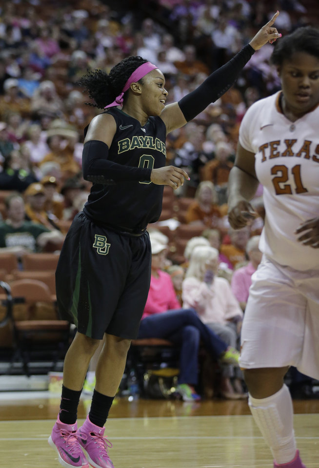 Photo - Baylor's Odyssey Sims (0) celebrates a score against Texas during the second half of an NCAA college basketball game on Sunday,  Feb. 16, 2014, in Austin, Texas. Baylor won 72-56 and Sims scored 34 points. (AP Photo/Eric Gay)