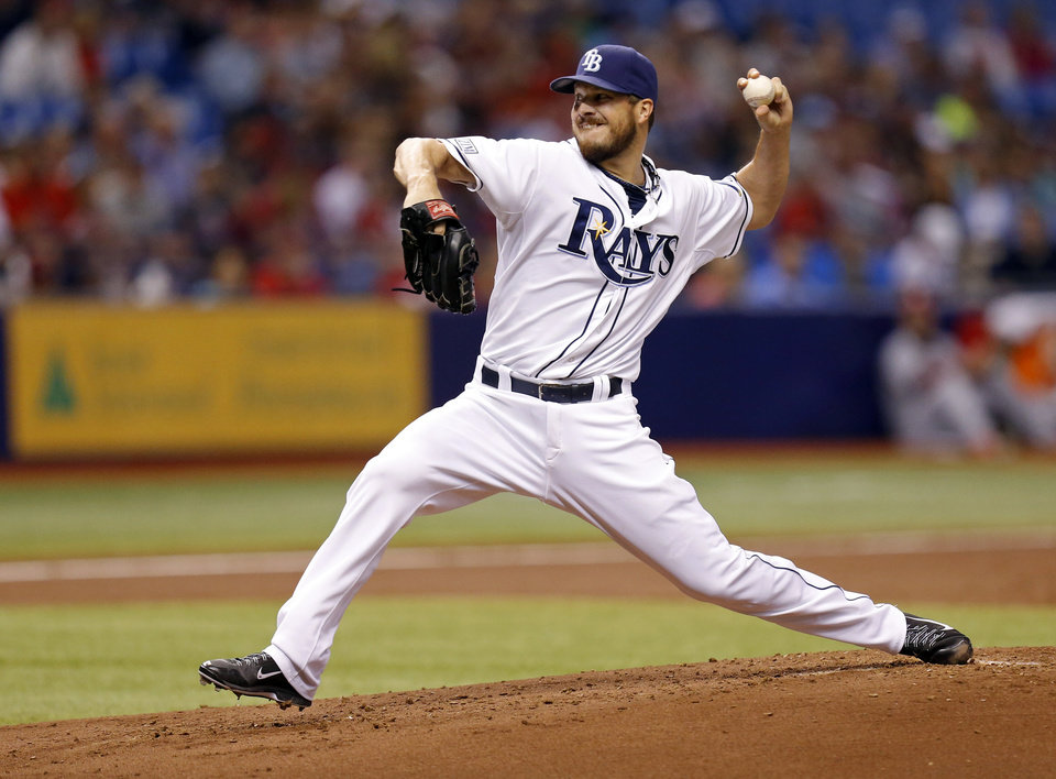 Photo - Tampa Bay Rays starting pitcher Erik Bedard throws during the second inning of a baseball game against the St. Louis Cardinals Wednesday, June 11, 2014, in St. Petersburg, Fla. (AP Photo/Mike Carlson)