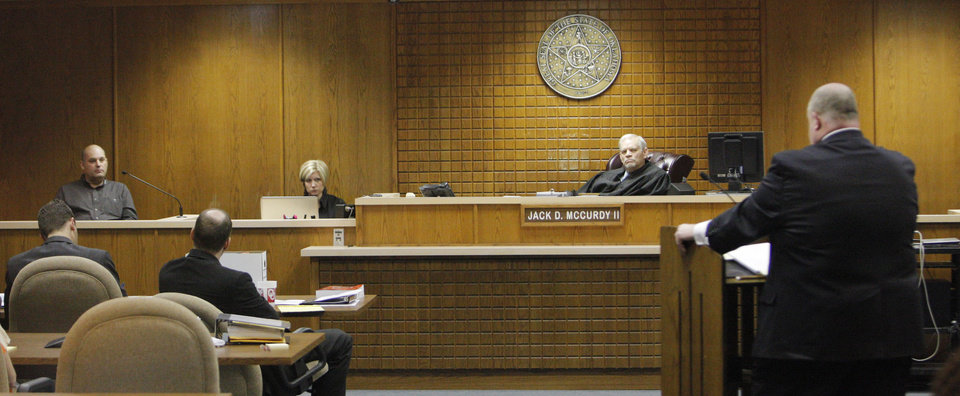 Mark Holbrook, far left, testifies during the preliminary hearing for Rebecca Bryan at the Canadian County Courthouse in El Reno Wednesday, March 14, 2012.  On the bench is Judge Jack McCurdy II. Photo by Paul B. Southerland, The Oklahoman