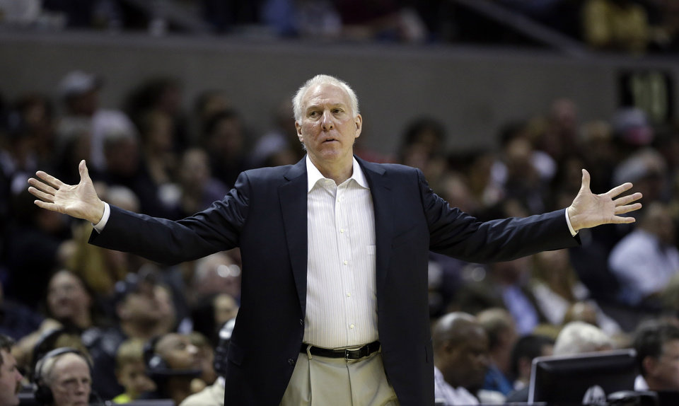 Photo - San Antonio Spurs head coach Gregg Popovich reacts during the first half of an NBA basketball game against the Washington Wizards, Saturday, Feb. 2, 2013, in San Antonio. (AP Photo/Eric Gay)