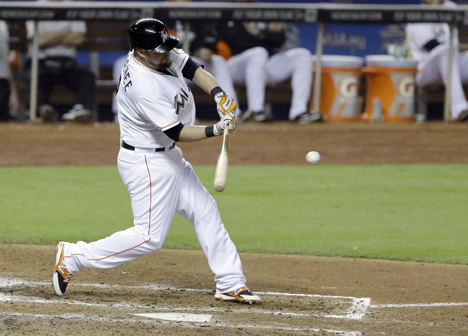 Photo - Miami Marlins' Casey McGehee hits a double, scoring Ed Lucas, during the fifth inning of a baseball game against the Philadelphia Phillies, Wednesday, July 2, 2014 in Miami. The Marlins defeated the Phillies 5-0. (AP Photo/Wilfredo Lee)