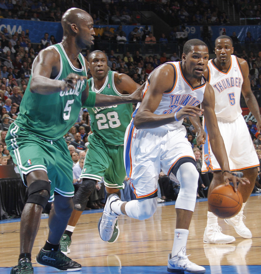 Oklahoma City Thunder small forward Kevin Durant (35) drives past Boston Celtics power forward Kevin Garnett (5) during the NBA basketball game between the Oklahoma City Thunder and the Boston Celtics at the Chesapeake Energy Arena on Wednesday, Feb. 22, 2012 in Oklahoma City, Okla.  Photo by Chris Landsberger, The Oklahoman