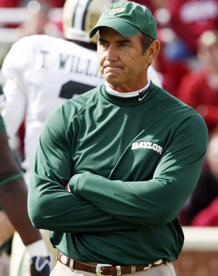 Photo - Baylor head coach Art Briles watches his team warm up before the college football game between The University of Oklahoma Sooners (OU) and the Baylor Bears at the Gaylord Family-Oklahoma Memeorial Stadium on Saturday, Oct. 10, 2009, in Norman, Okla.