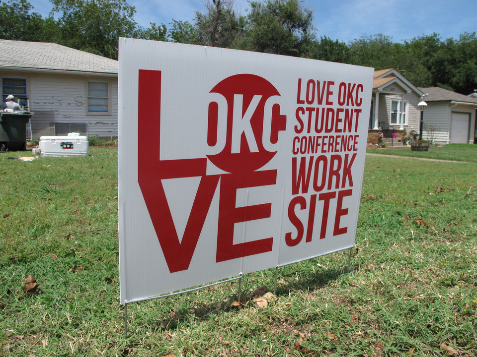 Photo - A sign in front of an Edmond home identifies the residence as oen that has been targeted by Love OKC youths from churches in the region.  The Oklahoman - CARLA HINTON