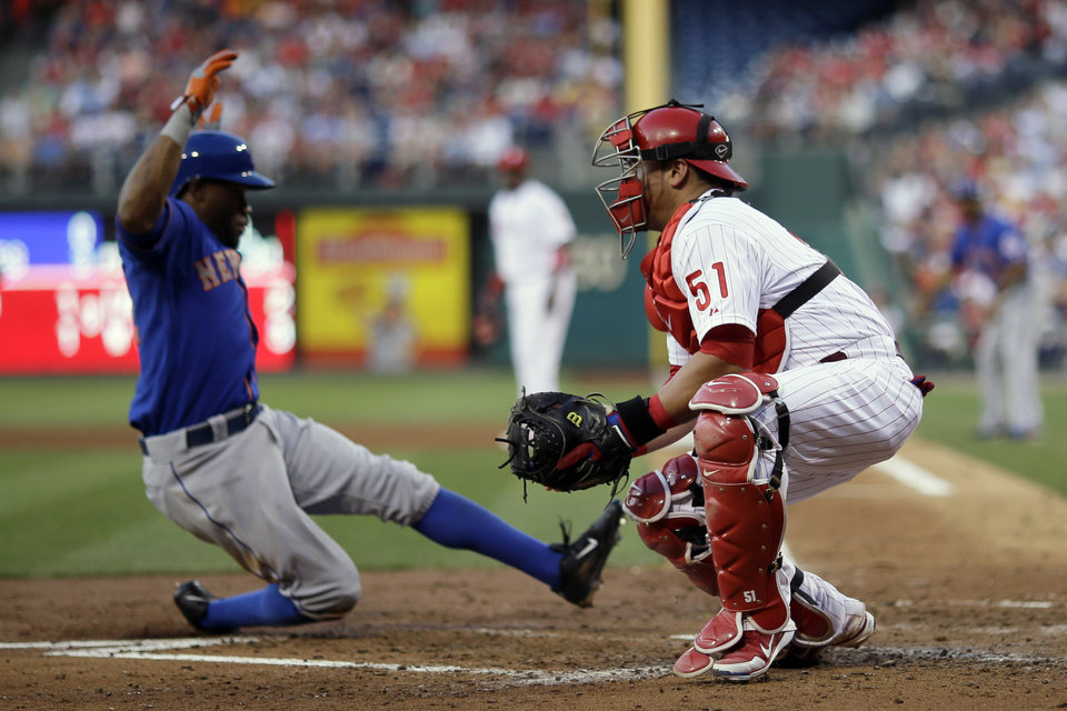 New York Mets' Eric Young Jr., left, scores past Philadelphia Phillies catcher Carlos Ruiz on a single by Mets' David Wright in the fourth inning of a baseball game on Friday, June 21, 2013, in Philadelphia. (AP Photo/Matt Slocum)