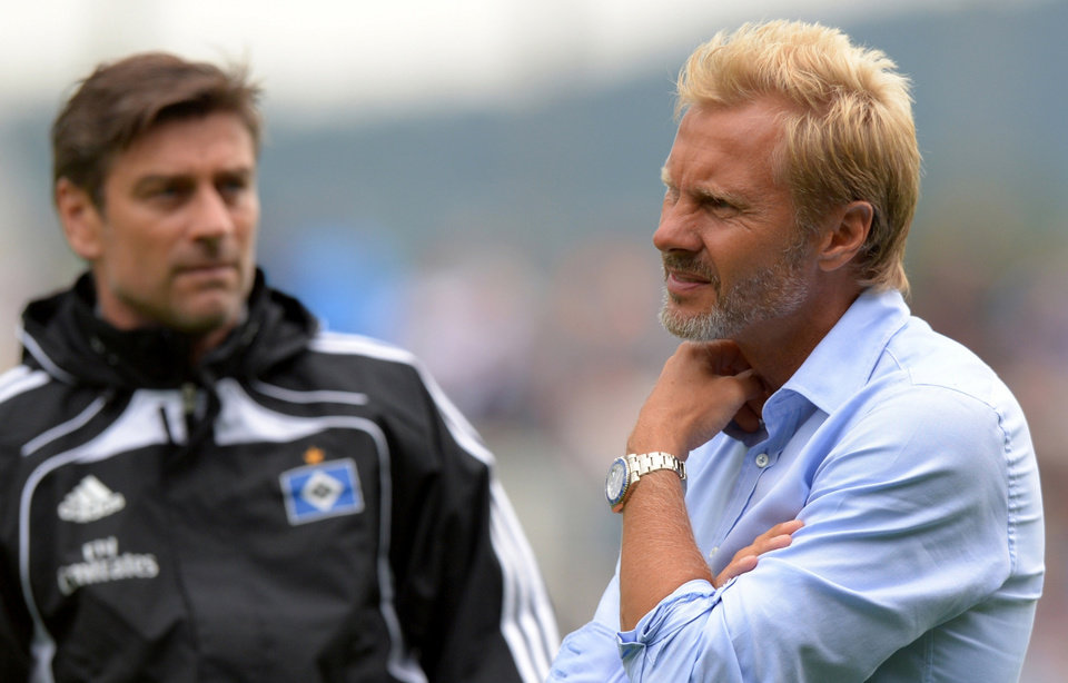 Photo - FILE - In this Aug. 4, 2013 file photo Hamburg's coach Thorsten Fink, right, stands next to sports director Oliver Kreuzer in Jena Germany. German media reports say Hamburger SV has sacked Fink as coach following the side's disappointing start to the Bundesliga. Bild is reporting that sports director Kreuzer confirmed the 45-year-old Fink would be fired at 10pm local time on Monday, Sept. 16, 2013, and Kicker says Fink has been informed of the decision. (AP Photo/dpa, Thomas Eisenhuth, File)
