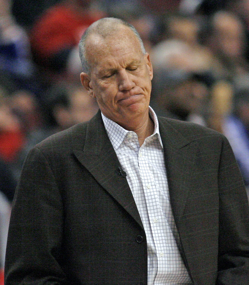 Photo - Philadelphia 76ers coach Doug Collins reacts to his team's play against the San Antonio Spurs in the first half of an NBA basketball game Monday, Jan. 21, 2013, in Philadelphia. (AP Photo H. Rumph Jr)