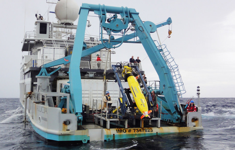 Photo - This 2011 photo provided by Sylvain Pascaud shows the ship Alucia and the REMUS 6000 robot sub during the search for Air France Flight 447. Unmanned subs, also called autonomous underwater vehicles or AUVs, played a critical role in locating the wreckage of the lost Air France jet, two years after it crashed in the middle of the south Atlantic. The find allowed searchers to recover the black boxes that revealed the malfunctions behind the tragedy. (AP Photo/Sylvain Pascaud)