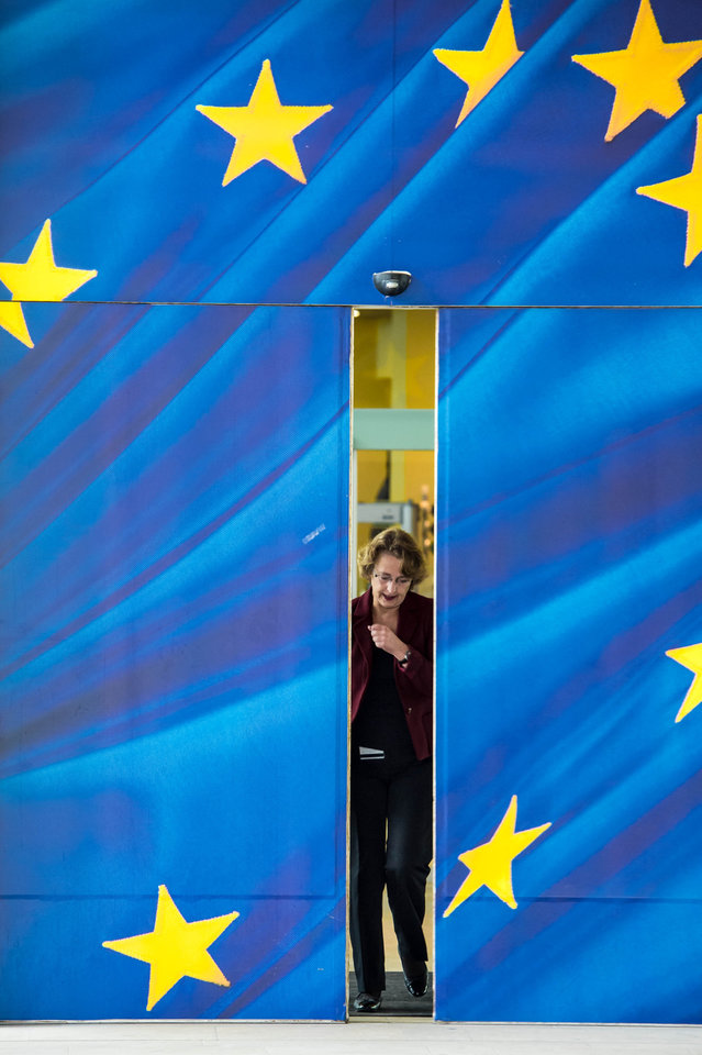 A woman leaves the European Commission headquarters in Brussels, Friday, Oct. 12, 2012. The European Union won the Nobel Peace Prize on Friday for its efforts to promote peace and democracy in Europe, an award given even though the bloc is struggling with its biggest crisis since it was created in the 1950s. (AP Photo/Geert Vanden Wijngaert) ORG XMIT: GVW102