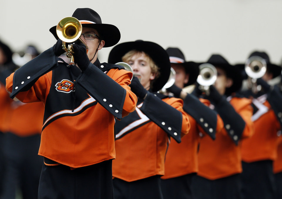 Photo - The OSU Cowboy Marching Band performs before a college football game between Oklahoma State University and the University of Louisiana-Lafayette (ULL) at Boone Pickens Stadium in Stillwater, Okla., Saturday, Sept. 15, 2012. Photo by Nate Billings, The Oklahoman