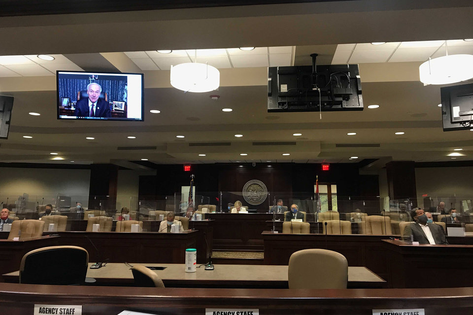 Photo -  FILE - In this Nov. 10, 2020 file photo, Arkansas Gov. Asa Hutchinson speaks remotely to legislators in Little Rock, Ark. At least 187 state legislators nationwide have tested positive for the virus and four have died since the pandemic began, according to figures compiled by The Associated Press. Twelve Arkansas lawmakers have tested positive for the virus over the past month, the second largest known outbreak in a state legislature. (AP Photo/Andrew Demillo File)
