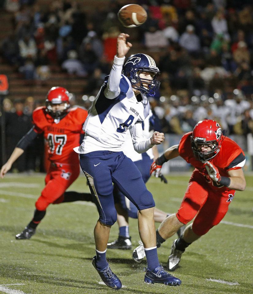 Southmoore's Conner Uselton as Mustang's Clay Trotter approaches during their high school football game in Mustang, Okla., Friday, November 8, 2013. Photo by Bryan Terry, The Oklahoman