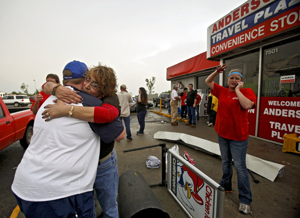 Photo - Staci Harris, left, hugs fellow employee Stacey Hendley outside the Anderson Travel Plaza after a tornado damaged the area around I-40 and Choctaw Road on Monday, May 10, 2010, in Oklahoma City, Okla.  Photo by Chris Landsberger, The Oklahoman