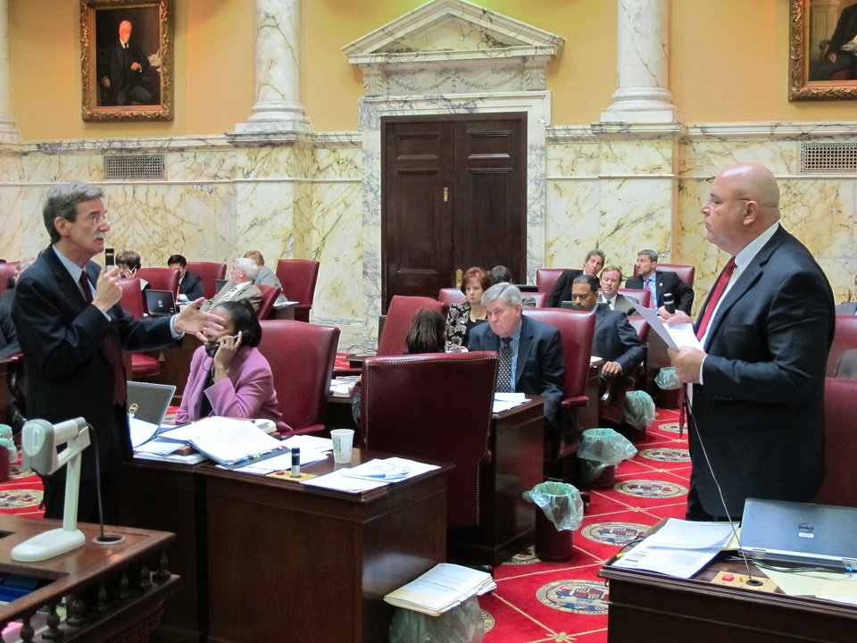 Photo - Democratic Sen. Brian Frosh (standing left) discusses a Maryland gun-control bill with Sen. E.J. Pipkin (standing right), R-Cecil, on Tuesday, Feb. 26, 2013 in the state Senate in Annapolis, Md. (AP Photo/Brian Witte)