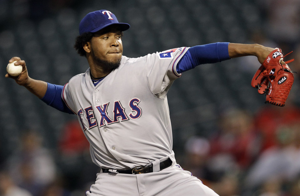 Photo -   Texas Rangers starting pitcher Neftali Feliz throws to the Baltimore Orioles in the second inning of a baseball game in Baltimore, Tuesday, May 8, 2012. (AP Photo/Patrick Semansky)