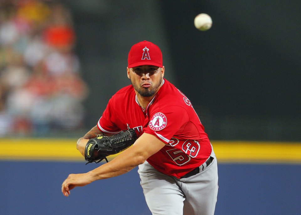 Photo - Los Angeles Angels starting pitcher Hector Santiago (53) delivers in the first inning inning of a baseball game against the Atlanta Braves, Sunday, June 15, 2014, in Atlanta. (AP Photo/Todd Kirkland)