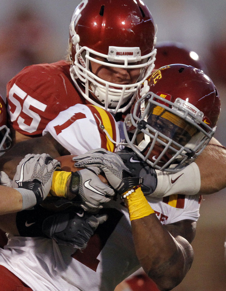 Oklahoma's Jayden Bird (55) stops Iowa State's Davis Sims (1) on a kick return during the first half of the college football game between the University of Oklahoma Sooners (OU) and the Iowa State Cyclones (ISU) at the Glaylord Family-Oklahoma Memorial Stadium on Saturday, Oct. 16, 2010, in Norman, Okla.  Photo by Chris Landsberger, The Oklahoman