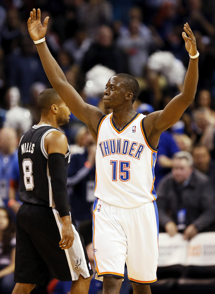 Oklahoma City's Reggie Jackson (15) celebrates in front of San Antonio's Patty Mills (8) in the second half during an NBA basketball game between the Oklahoma City Thunder and the San Antonio Spurs at Chesapeake Energy Arena in Oklahoma City, Wednesday, Nov. 27, 2013. Oklahoma City won, 94-88. Photo by Nate Billings, The Oklahoman
