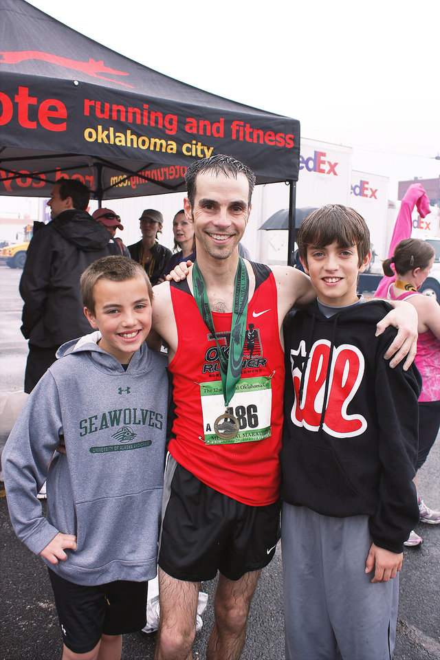 Left to right is Theo (10 at time of photo, now 11), Adam, and Will (13) Cohen at the Oklahoma City Memorial Marathon.  Photo by Julie Cohen.  <strong></strong>