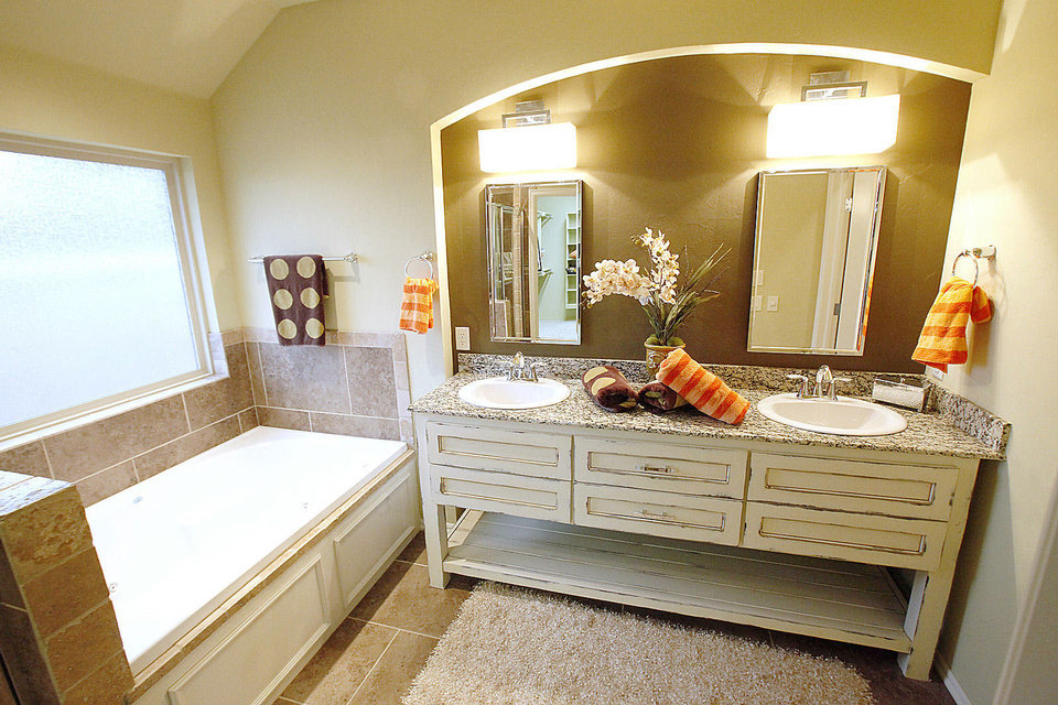 A double vanity adds extra function to the master bath in the McCaleb Homes model in the Arbor Creek neighborhood. <strong>David McDaniel - The Oklahoman</strong>