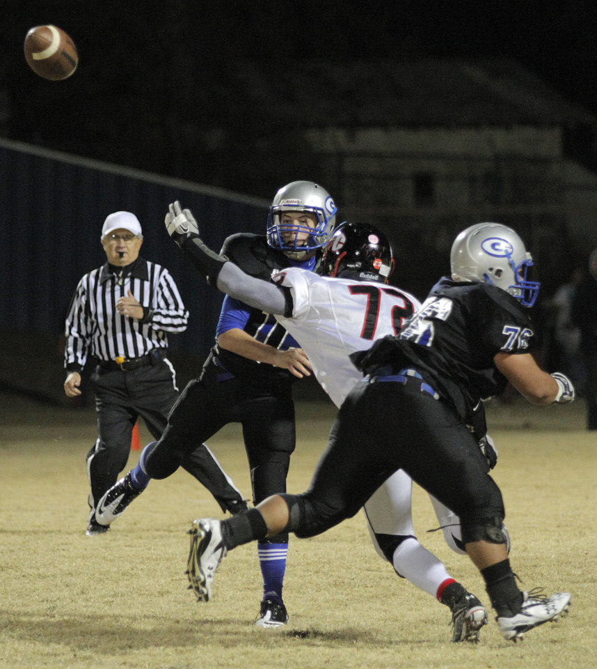 Photo - Guthrie's Bryan Dutton (16) throws a ball during a high school football game between Guthrie and East Central at The Rock in Guthrie, Friday, Nov. 18, 2011.  Photo by Garett Fisbeck, The Oklahoman