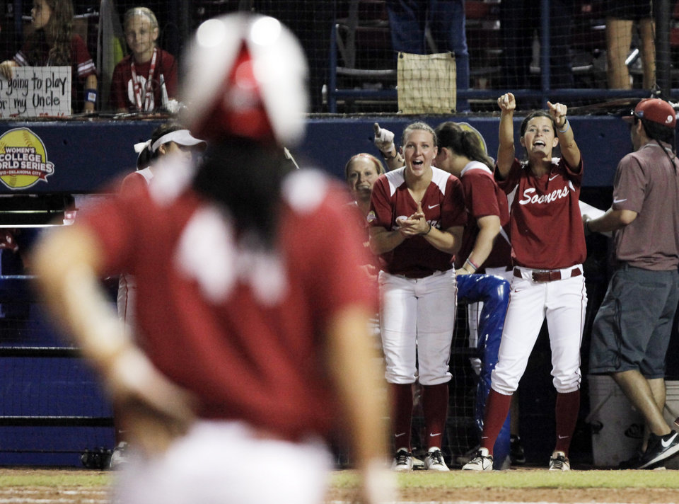 Members of the Oklahoma bench celebrate Lauren Chamberlain reaching third base in the final inning of the WCWS Finals second game where Oklahoma defeated Tennessee 4-0 on June 4, 2013 to win the NCAA championship. Photo by KT KING, The Oklahoman