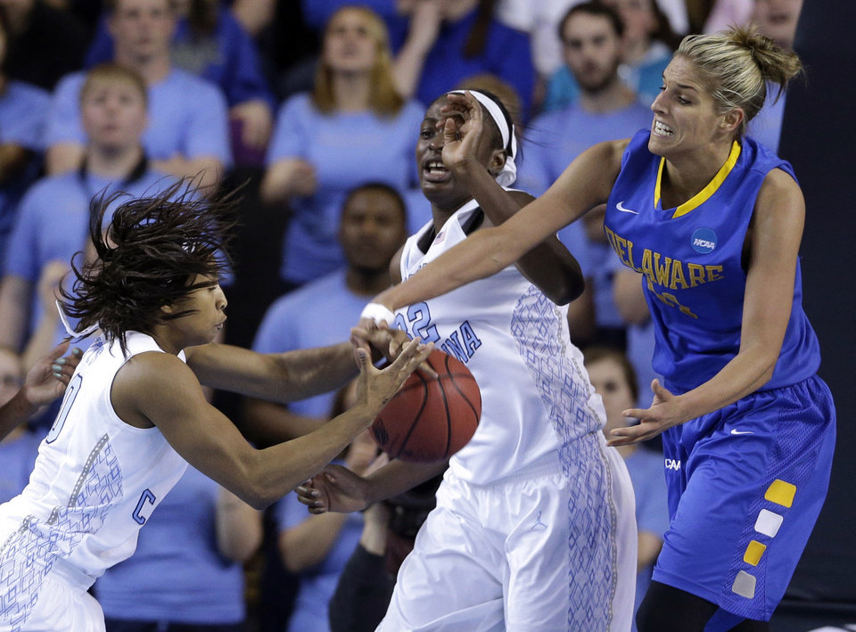 Photo - North Carolina guard Danielle Butts, left, and center Waltiea Rolle try to rebound a ball  against Delaware guard/forward Elena Delle Donne during the second half of a second-round game in the women's NCAA college basketball tournament in Newark, Del., Tuesday, March 26, 2013. Delaware won 78-69. (AP Photo/Patrick Semansky)