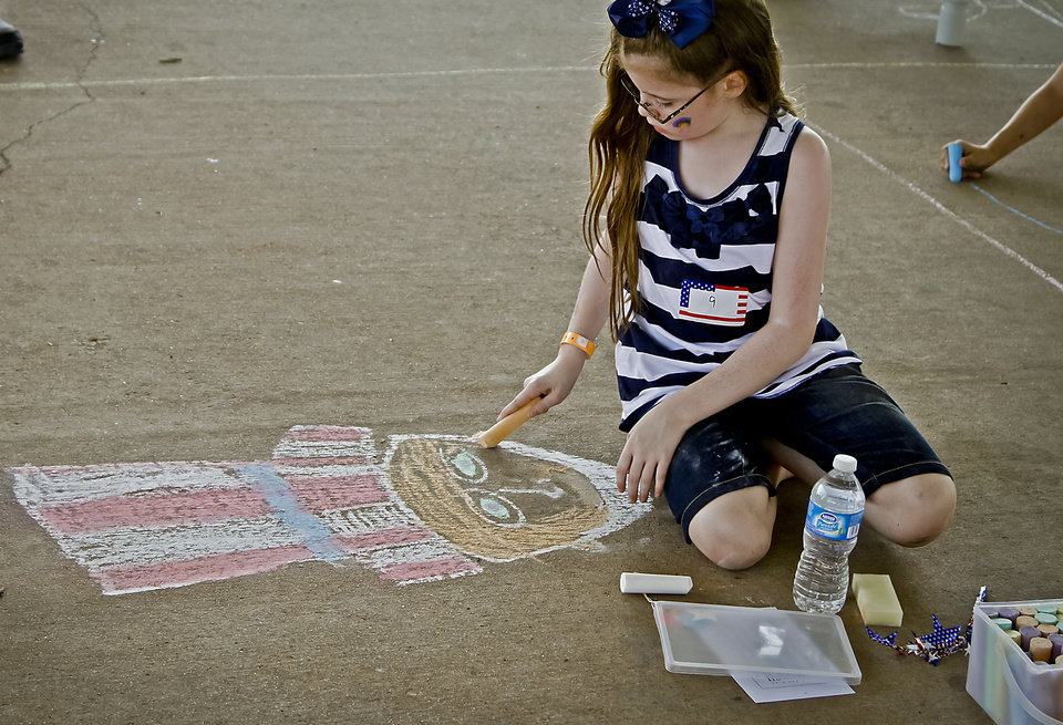 Tagan Myatt works on her artwork during the sidewalk chalk contest in Downtown Edmond on Friday, June 29, 2012, in Edmond, Oklahoma. Photo by Chris Landsberger, The Oklahoman