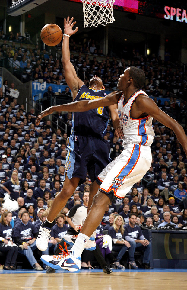Oklahoma City's Kevin Durant (35) blocks Denver's Arron Afflalo's (6) shot during the NBA basketball game between the Denver Nuggets and the Oklahoma City Thunder in the first round of the NBA playoffs at the Oklahoma City Arena, Wednesday, April 27, 2011. Photo by Sarah Phipps, The Oklahoman