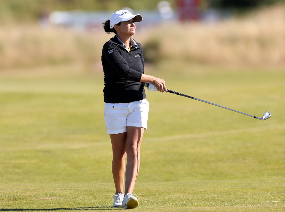 Photo - Mo Martin of the US plays a shot from the 10th fairway during the second day of the Women's British Open golf championship on the Royal Birkdale Golf Club, Southport, England, Friday July 11, 2014. (AP Photo/Scott Heppell)