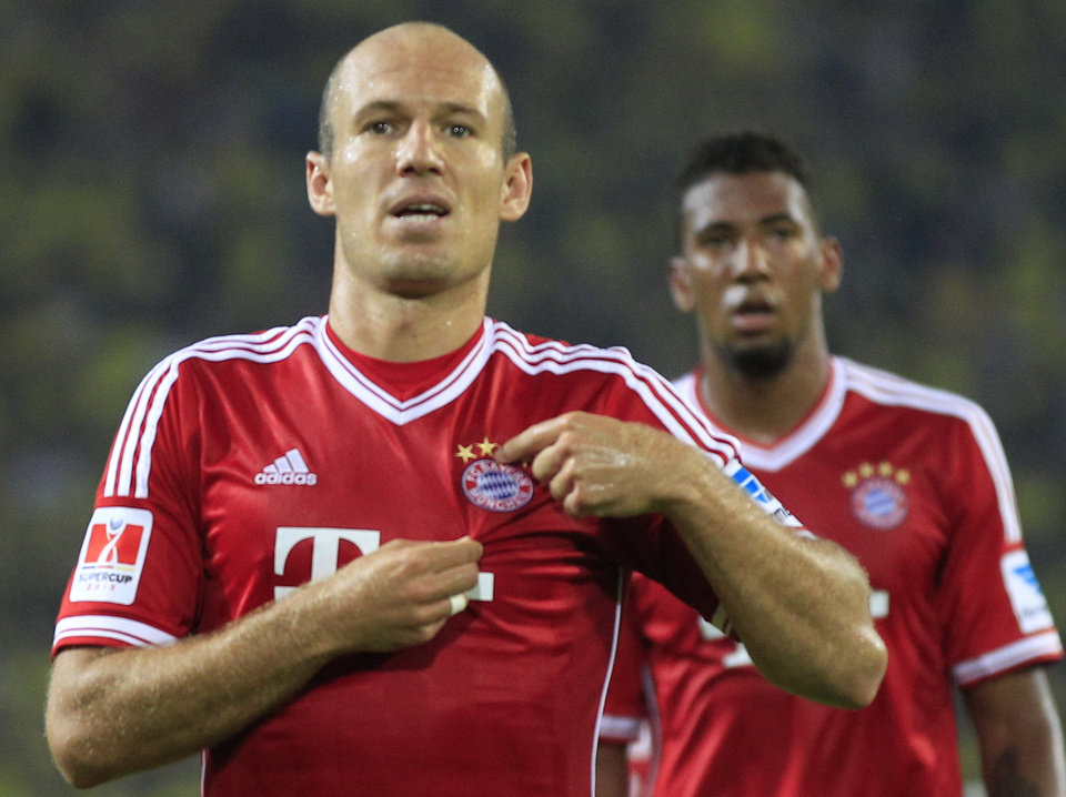 Photo - Bayern's Arjen Robben of the Netherlands celebrates after scoring  during the Supercup final soccer match between BvB Borussia Dortmund  and Bayern Munich in Dortmund, Germany, Saturday, July 27, 2013. (AP Photo/Frank Augstein)