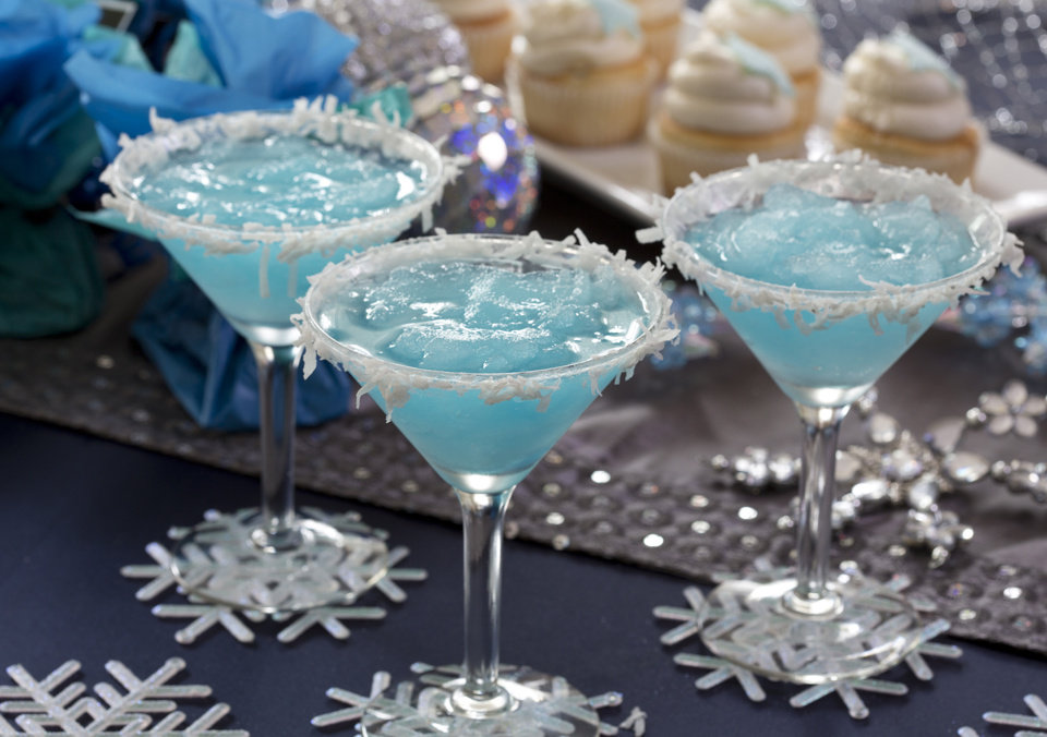 Photo - For holiday entertaining try a Jack Frost party theme with martinis made from pineapple juice, coconut, vodka and blue curacao. (Ross Hailey/Fort Worth Star-Telegram/MCT)