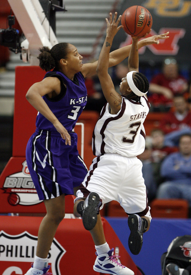 Aggie Takia Starks shoots over the block of Jalana Childs during the 2009 Big 12 Women's Basketball Championship game between Kansas State Wildcats and the Texas A&M Aggies in the Cox Convention Center in Oklahoma City, Oklahoma, on Friday, March 13, 2009. 