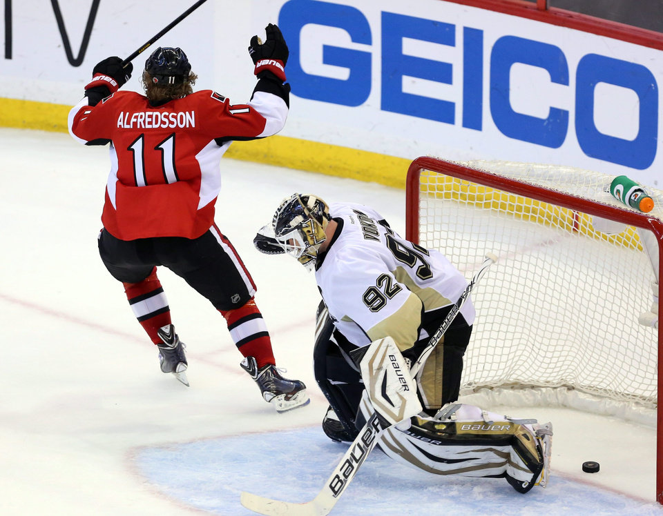 Photo - Ottawa Senators' Daniel Alfredsson (11) celebrates as he scores on Pittsburgh Penguins goaltender Tomas Vokoun (92) during the third period of Game 4 of the Eastern Conference Stanley Cup semifinal NHL hockey series on Sunday, May 19, 2013, in Ottawa. (AP Photo/The Canadian Press, Fred Chartrand)