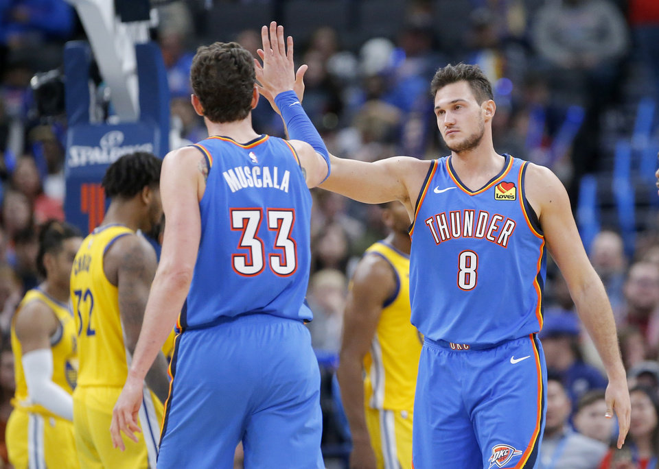 Photo - Oklahoma City's Danilo Gallinari (8) high fives Mike Muscala (33) during the NBA game between the Oklahoma City Thunder and the Golden State Warriors at Chesapeake Energy Arena,   Saturday, Nov. 9, 2019.  [Sarah Phipps/The Oklahoman]