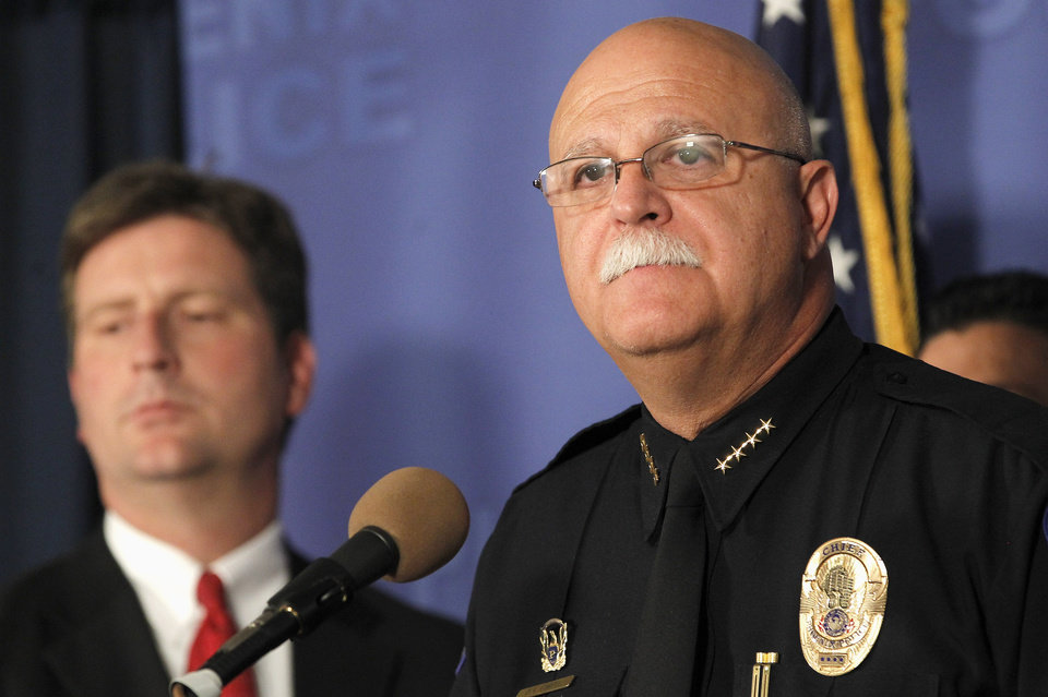 Photo - Phoenix Chief of Police Daniel Garcia, right, pauses while speaking at a news conference as Phoenix Mayor Greg Stanton, left, listens in at Phoenix Police Headquarters, on Thursday, June 12, 2014, in Phoenix, speaking about a Wednesday evening attack that left a priest shot and killed and another injured at the Roman Catholic church the Mother of Mercy Mission.  Police have no suspects at this point, but they are canvassing the neighborhood and going over physical evidence from the scene. (AP Photo/Ross D. Franklin)